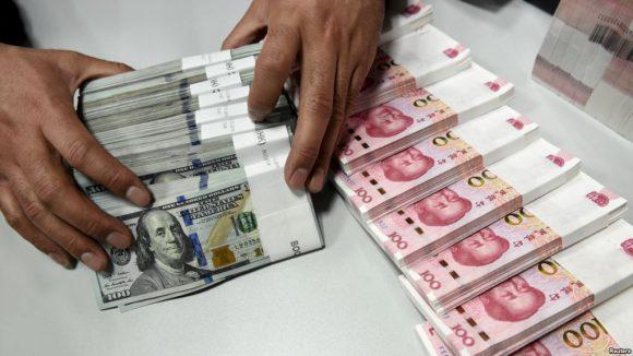 Dollaro e Yuan a confronto